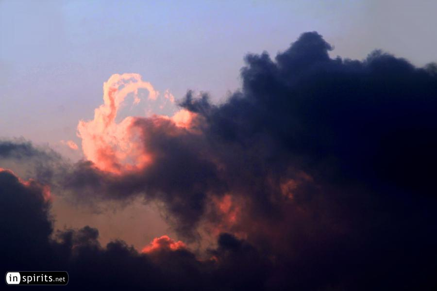 Sunset clouds paint a dragon on the sky