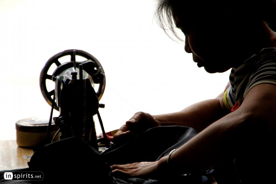 Chinese Woman on a Sewing Machine in Guangxi