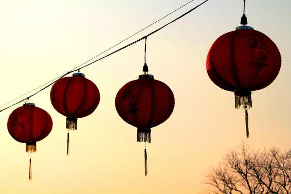 Chinese lanterns glow in the winter sunset