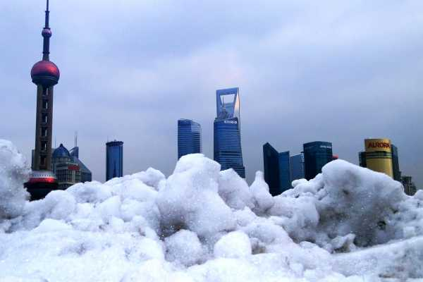 Shanghai's skyscrapers clad in snow