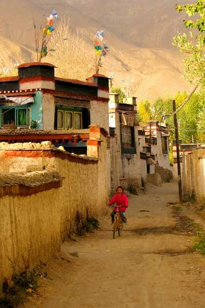 A Tibetan girl's bike tour in autumn