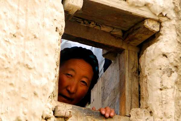 Tibetan woman in Gyantse appears in the window