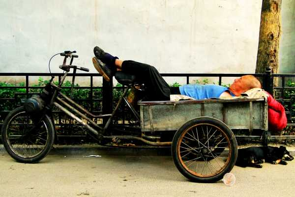 Napping on a tricycle in a Beijing hutong