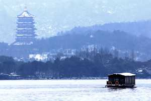Chinese Boat on icy West Lake in Winter